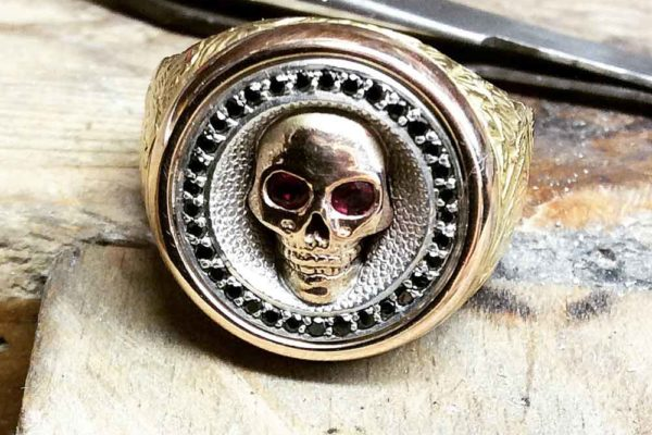 Gold and black diamond skull ring