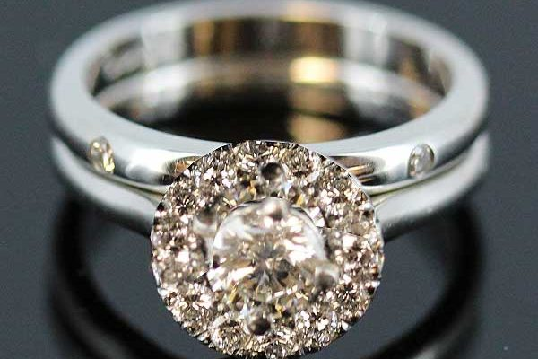Halo engagement ring with fitted wedding band
