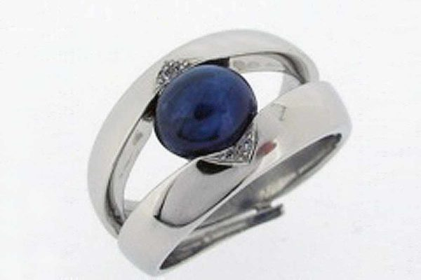 Platinum band with cabochon sapphire and diamond details