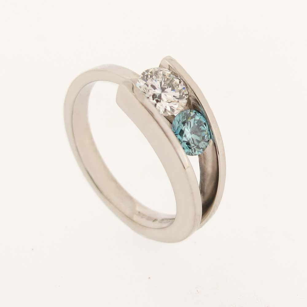 White gold ring with white and blue diamonds