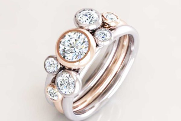 Concentric gold and diamond cluster rings