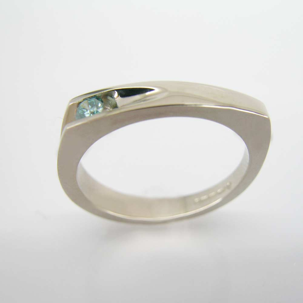 Groove white gold ring with blue diamond