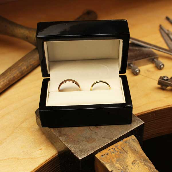 Two handmade wedding rings in a box