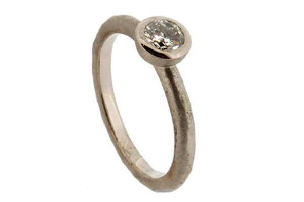 Molten white gold diamond solitaire ring