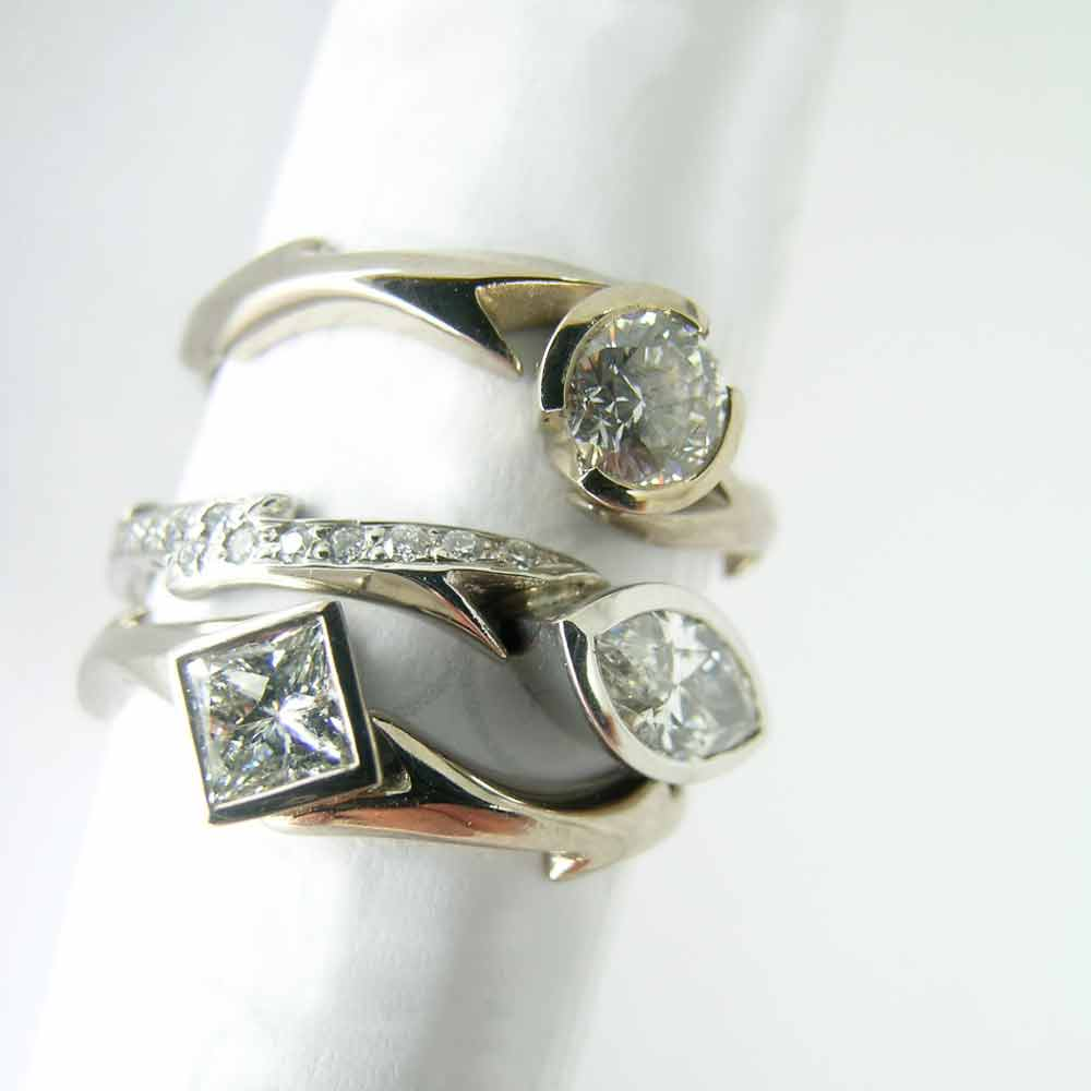 Diamond engagement rings with thorn bands