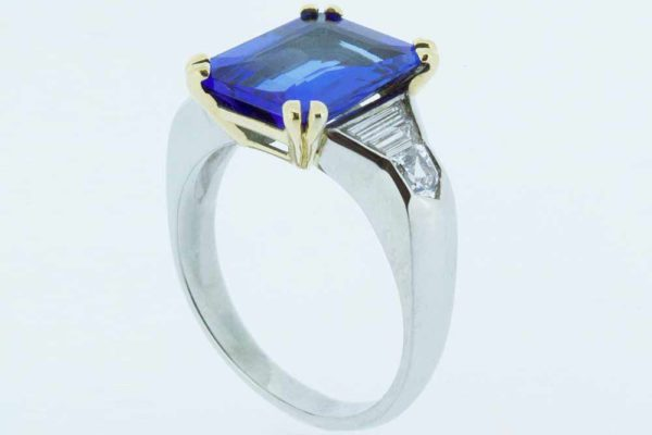 Platinum claw-set sapphire ring with baguette diamonds