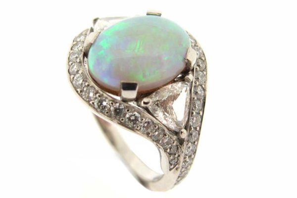 Platinum cabochon opal and diamond ring
