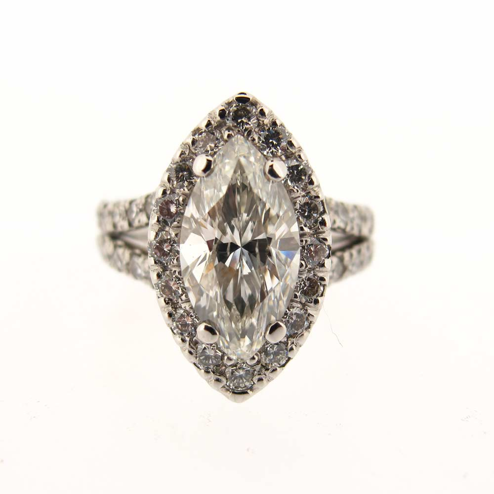 Platinum marquise diamond halo ring
