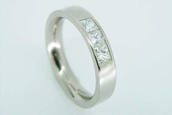 Platinum square cut diamond band