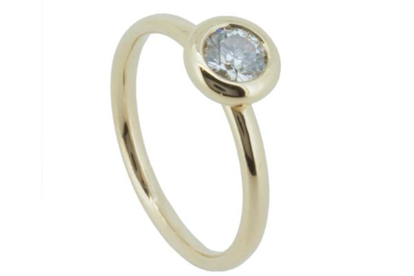 Concentric white gold diamond solitaire ring