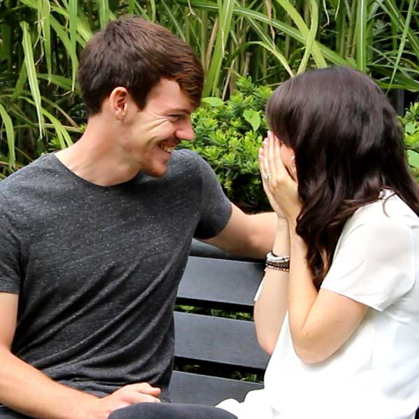 Happy couple after surprise proposal