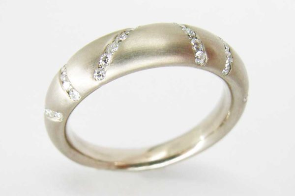 Platinum band with channel set diamonds