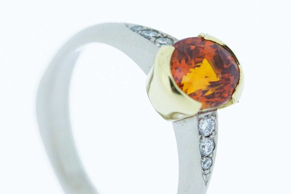 Platinum diamond ring with padparadscha sapphire set in yellow gold