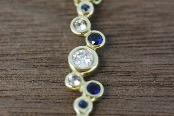 Yellow gold diamond and sapphire drop necklace