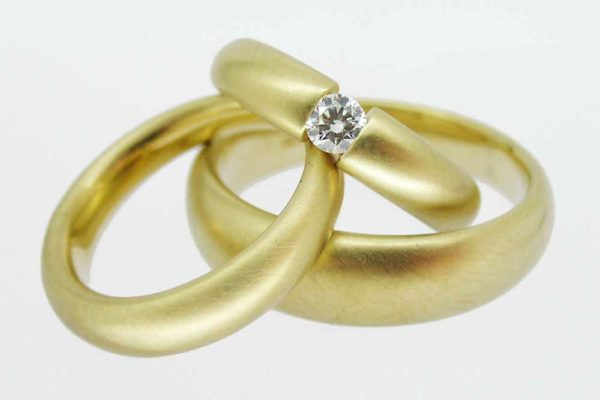 Yellow gold tension-set diamond wedding set