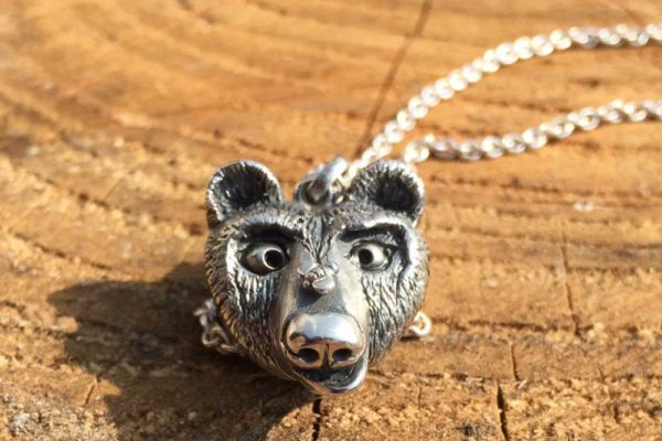 Silver boss-eyed bear and bee necklace